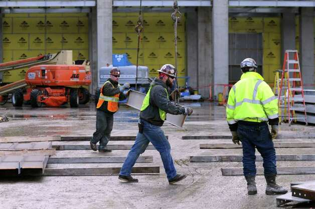 Construction workers move materials for Fab Phase II on Wednesday, Jan. 5, 2011, at GlobalFoundries in Malta, N.Y. (Cindy Schultz / Times Union) Photo: Cindy Schultz / 00011647A