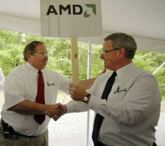 TIMES UNION STAFF PHOTO WILL WALDRON--Kenneth Green, President of Saratoga Economic Development Corp, right, is congratulated by SEDC Senior Vice President Jack Kelley, left, after making the announcement of an AMD chip fabrication plant to be built on the Luther Forest Tech Park in Malta, during a press conference Friday afternoon June 23, 2006. Photo: WW / ALBANY TIMES UNION
