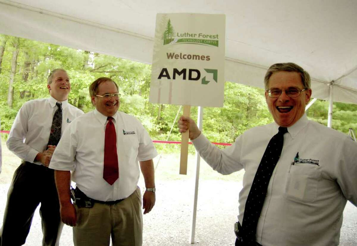 Kenneth Green, President of Saratoga Economic Development Corp, right, celebrates the announcement of an AMD chip fabrication plant to be built on the Luther Forest Tech Park in Malta, with SEDC Senior Vice President Jack Kelley, center, and Jon Dawes, left, also from SEDC, during a press conference Friday afternoon June 23, 2006. AMD would later spin off its manufacturing into GlobalFoundries.