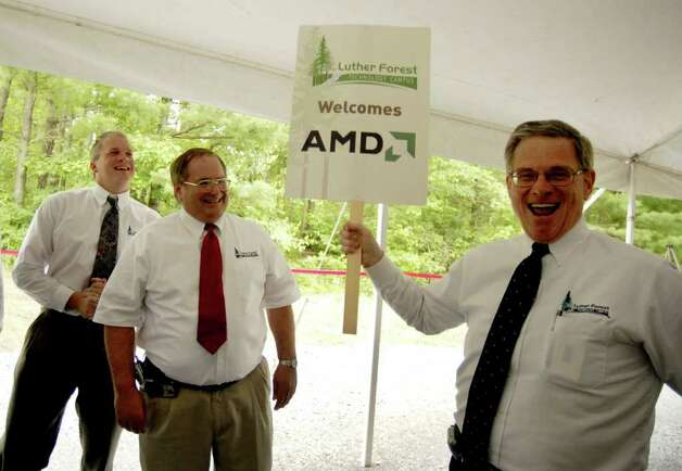 TIMES UNION STAFF PHOTO BY WILL WALDRON       Kenneth Green, President of Saratoga Economic Development Corp, right, celebrates the announcement of an AMD chip fabrication plant to be built on the Luther Forest Tech Park in Malta, with SEDC Senior Vice President Jack Kelley, center, and Jon Dawes, left, also from SEDC, during a press conference Friday afternoon June 23, 2006. Photo: WW / ALBANY TIMES UNION