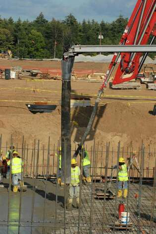 Construction workers pour concrete at the Fab 2 site at Luther Forest in Malta, NY on September 9, 2009. GlobalFoundries transported its employees by bus to view the contruction site. (Lori Van Buren / Times Union) Photo: LORI VAN BUREN/TIMES UNION / 00005443A