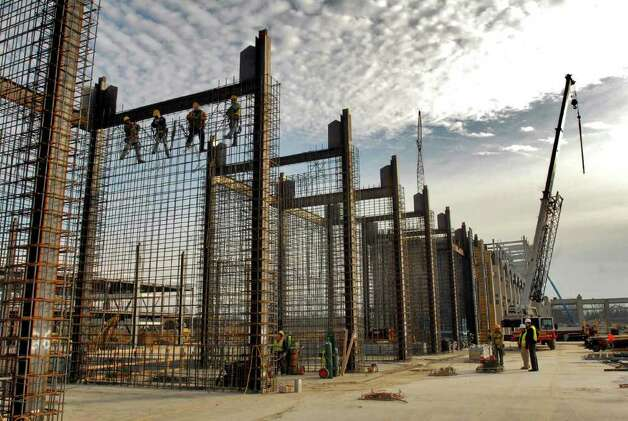Ironworkers install rebar before concrete is poured for sheer walls, part of the bracing for the building,  at the GlobalFoundries Fab 2 Module 1 site chip fabrication plant under construction at the Luther Forest Technology Campus in Malta, NY on  Wednesday December 2, 2009.  The walls are 35 feet high.  (Philip Kamrass /  Times Union) Photo: PHILIP KAMRASS / 00006649A