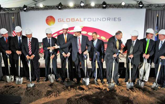 Dignitaries congratulate each other after breaking ground on GobalFoundries' $4.2 billion computer chip factory in Malta Friday July 24, 2009.  (John Carl D'Annibale / Times Union) Photo: John Carl D'Annibale / 00004795A