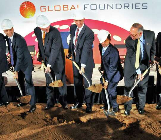 NYS Gov. David Paterson's hard hat slips off his head as he and other dignitaries break ground on GobalFoundries' $4.2 billion computer chip factory in Malta Friday July 24, 2009.  From left are :  Ibrahim Ajami, CEO Advanced Technology Investment Co., Doug Grose, CEO GlobalFoundries, Dirk Meyers, CEO of AMD, Go. Paterson, and US Senator Charles Schumer.   (John Carl D'Annibale / Times Union) Photo: John Carl D'Annibale / 00004795A