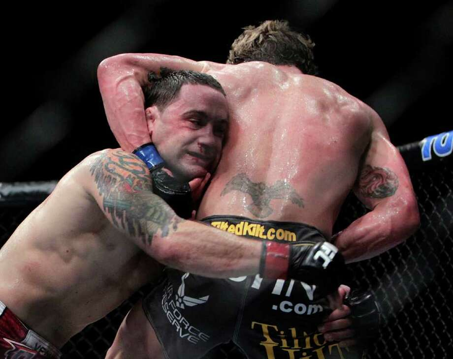 "Frankie ""The Answer""  Edgar, left, fights Gray ""The Bully"" Maynard in the during the UFC 136 lightweight title bout at Toyota Center Saturday, Oct. 8, 2011, in Houston. 