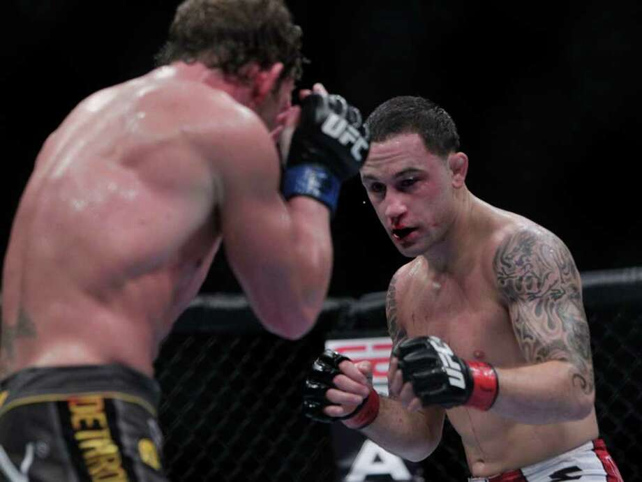 "Frankie ""The Answer""  Edgar, right, fights Gray ""The Bully"" Maynard in the during the UFC 136 lightweight title bout at Toyota Center Saturday, Oct. 8, 2011, in Houston. 