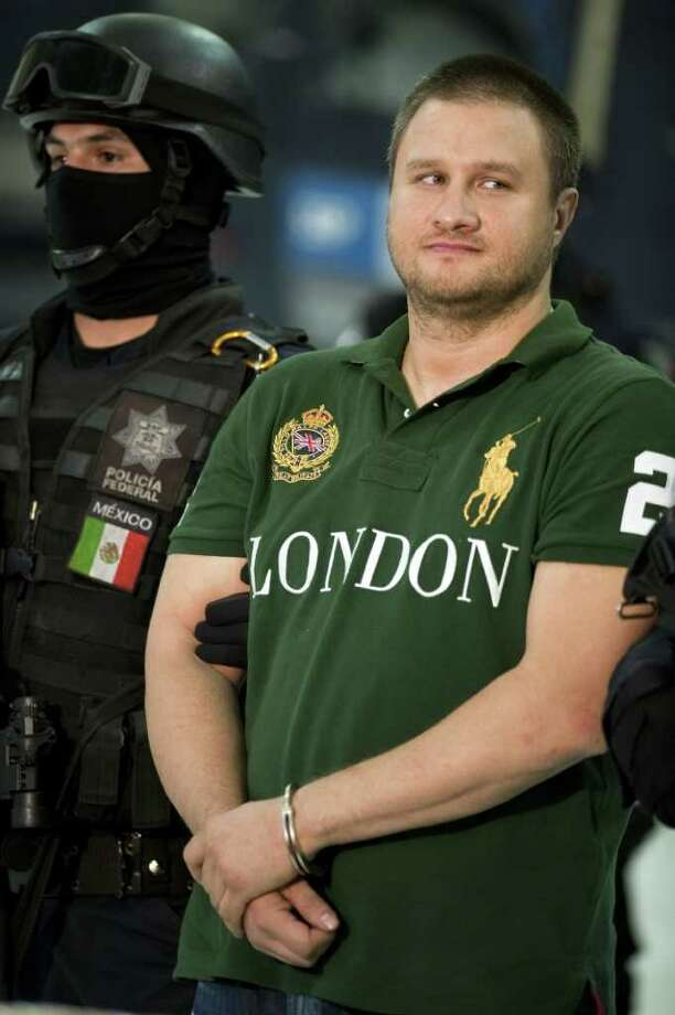 "Edgar Valdez Villarreal, known as ""La Barbie,"" for his light hair and eyes, a former Beltrán Leyva hit man and operative. A U.S. citizen born in Laredo, he was arrested in Mexico in August 2010. Photo: ALFREDO ESTRELLA, File Photo / 2010 AFP"