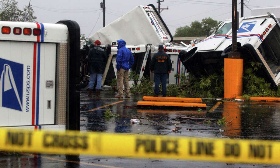 U.S. Postal trucks at the Valley Hi branch of the U.S Post Office were tossed about after high winds swept through the area early Sunday October 9, 2011. Photo: JOHN DAVENPORT/jdavenport@express-news.net / SAN ANTONIO EXPRESS-NEWS (Photo can be sold to the public)