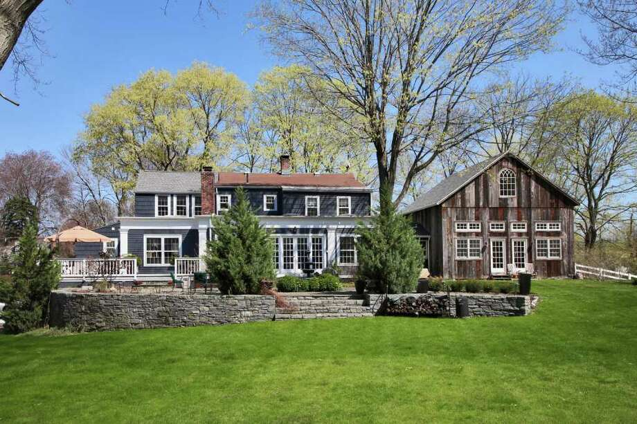 Farmhouse cultivates modern amenities vintage for Barn homes for sale in ct