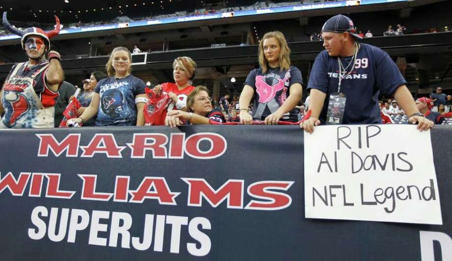 Houston Texans fans show their appreciation for long time Oakland Raiders owner Al Davis, who passed away early Saturday morning, before an NFL football game between the Oakland Raiders and Houston Texans at Reliant Stadium, Sunday, Oct. 9, 2011, in Houston. Photo: Karen Warren, Houston Chronicle / © 2011 Houston Chronicle