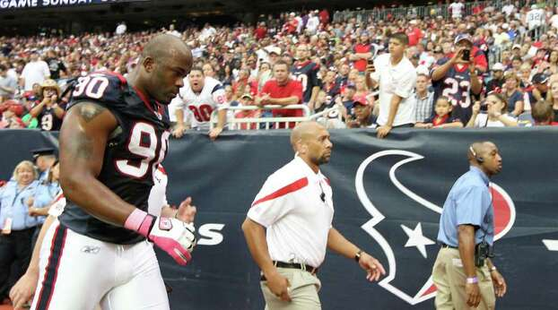 Houston Texans outside linebacker Mario Williams (90) leaves the game during the first quarter of an NFL football game against the Oakland Raiders at Reliant Stadium, Sunday, Oct. 9, 2011, in Houston. Photo: Karen Warren, Houston Chronicle / © 2011 Houston Chronicle