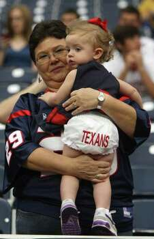 Pam Alexander, of Mississippi, shows her granddaughter Ardynn Wilson's, 23-months, embroidered Texans panties before an NFL football game between the Texans and Oakland Raiders at Reliant Stadium, Sunday, Oct. 9, 2011, in Houston. Photo: Karen Warren, Houston Chronicle / © 2011 Houston Chronicle