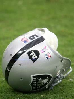 The Oakland Raiders are wearing a decal to honor their owner Al Davis, who passed away Saturday morning. The Raiders are playing the Houston Texans at Reliant Stadium, Sunday, Oct. 9, 2011, in Houston. Photo: Karen Warren, Houston Chronicle / © 2011 Houston Chronicle