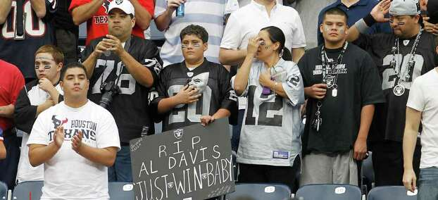 Oakland Raiders fans acknowledge a moment of silence for Oakland Raiders owner Al davis at the beginning of an NFL football game at Reliant Stadium, Sunday, Oct. 9, 2011, in Houston. Davis died Saturday morning. Photo: Karen Warren, Houston Chronicle / © 2011 Houston Chronicle