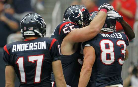 Houston Texans wide receiver David Anderson (17) and Texans center Chris Myers (55) celebrate with Texans wide receiver Kevin Walter (83) who scored a touch down during the first quarter of an NFL football game at Reliant Stadium, Sunday, Oct. 9, 2011, in Houston. Photo: Karen Warren, Houston Chronicle / © 2011 Houston Chronicle