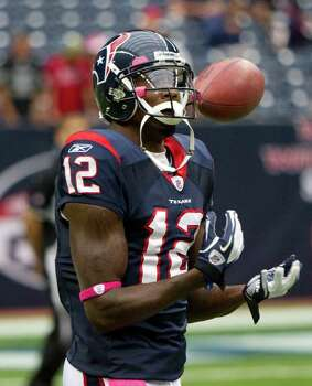 Houston Texans wide receiver Jacoby Jones (12) flips the ball around as he warms up for an NFL football game against the Oakland Raiders at Reliant Stadium on Sunday, Oct. 9, 2011, in Houston. Photo: Brett Coomer, Houston Chronicle / © 2011  Houston Chronicle