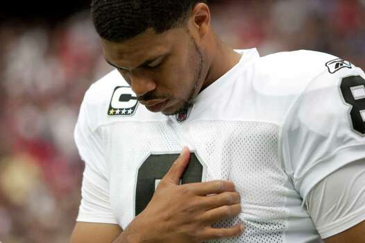 Oakland Raiders quarterback Jason Campbell (8) lowers his head during a moment of silence for Oakland Raiders owner Al davis who died Saturday. The Raiders are playing the Houston Texans in an NFL football game at Reliant Stadium on Sunday, Oct. 9, 2011, in Houston. Photo: Brett Coomer, Houston Chronicle / © 2011  Houston Chronicle