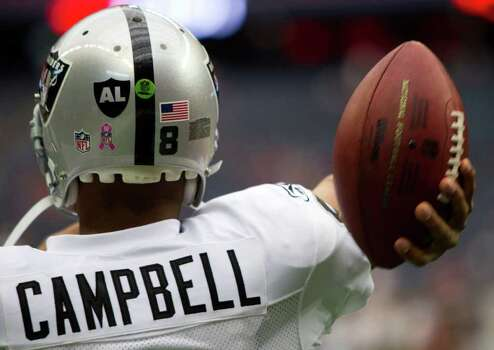 Oakland Raiders quarterback Jason Campbell (8) warms up for his NFL football game against the Houston Texans at Reliant Stadium on Sunday, Oct. 9, 2011, in Houston. The Oakland Raiders are wearing a decal honoring long time owner Al Davis, who died early Saturday morning. Photo: Brett Coomer, Houston Chronicle / © 2011  Houston Chronicle