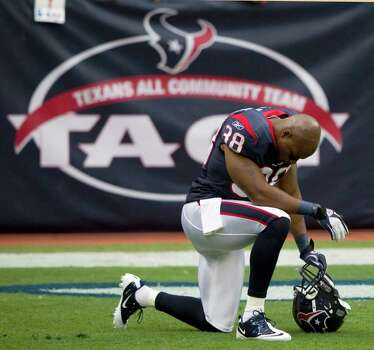 Houston Texans free safety Danieal Manning (38) takes a knee for a moment as he warms up for an NFL football game against the Oakland Raiders at Reliant Stadium on Sunday, Oct. 9, 2011, in Houston. Photo: Brett Coomer, Houston Chronicle / © 2011  Houston Chronicle