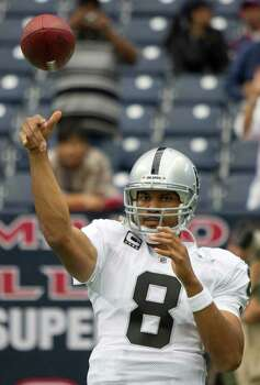 Oakland Raiders quarterback Jason Campbell (8) warms up for an NFL football game against the Houston Texans at Reliant Stadium on Sunday, Oct. 9, 2011, in Houston. Photo: Brett Coomer, Houston Chronicle / © 2011  Houston Chronicle