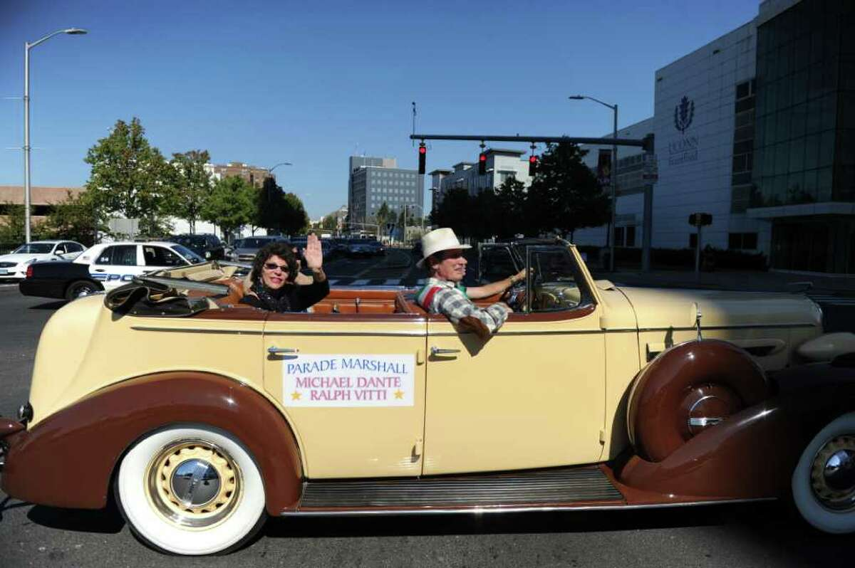 Mary Jane Dante rides with her husband actor and Stamford native Michael Dante as he serves as Grand Marshal in Stamford's Columbus Day Parade from Mill River to Columbus Park in Stamford, Conn., October 9, 2011.