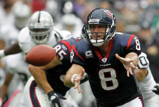 Houston Texans quarterback Matt Schaub (8) pitches the ball to Houston Texans running back Arian Foster (23) during the first quarter of an NFL football game at Reliant Stadium, Sunday, Oct. 9, 2011, in Houston. Photo: Karen Warren, Houston Chronicle / © 2011 Houston Chronicle