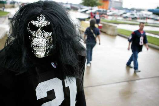Ben Fernandez, of Raider Nation and McKinney, Texas, walks shows his colors and attitude before a NFL football game between the Houston Texans and Oakland Raiders at Reliant Stadium on Sunday, Oct. 9, 2011, in Houston. Photo: Nick De La Torre, Houston Chronicle / © 2011  Houston Chronicle