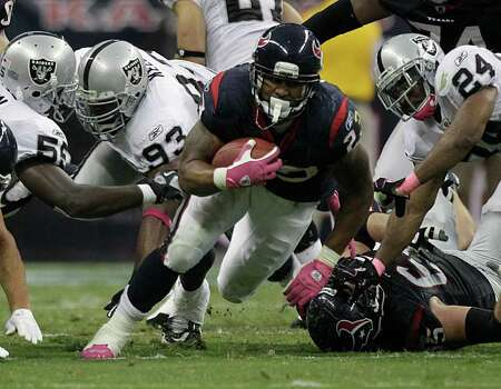 Houston Texans running back Arian Foster (23) finds a little of space to run in the Oakland Raiders defense during the second quarter of an NFL football game at Reliant Stadium on Sunday, Oct. 9, 2011, in Houston. Photo: Brett Coomer, Houston Chronicle / © 2011  Houston Chronicle