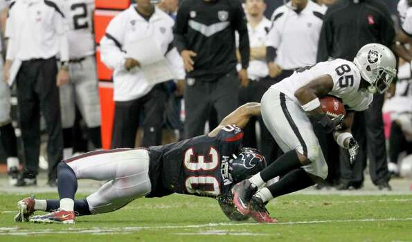 Oakland Raiders wide receiver Darrius Heyward-Bey (85) gets away from Houston Texans cornerback Jason Allen (30) for a touch down during the second quarter of an NFL football game at Reliant Stadium, Sunday, Oct. 9, 2011, in Houston. Photo: Karen Warren, Houston Chronicle / © 2011 Houston Chronicle