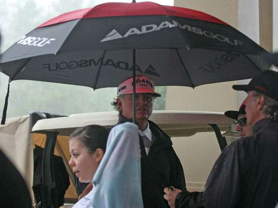 Second place finisher Tommy Armour III (center) waits for a shuttle after the final round of the Insperity Classic was postponed because of rain, Sunday, October 9, 2011 at the Tournament Course in The Woodlands, TX. Brad Faxon was the winner at 10-under-par, good enough for his first Champions Tour victory. Photo: Eric Christian Smith, For The Chronicle