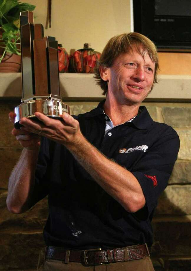 Insperity Classic champion Brad Faxon holds the champion's trophy after the final round of the Insperity Classic, Sunday, October 9, 2011 at the Tournament Course in The Woodlands, TX. The final round was canceled, and Brad Faxon was the winner at ten-under-par. It was Faxon's first Champions Tour victory. Photo: Eric Christian Smith, For The Chronicle