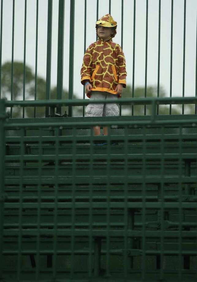 Dylan Magee, 5, waits out a weather delay in the No. 18 stands during the final round of the Insperity Classic, Sunday, October 9, 2011 at the Tournament Course in The Woodlands, TX. The final round was canceled, and Brad Faxon was the winner at ten-under-par, and it was Faxon's first Champions Tour victory. Photo: Eric Christian Smith, For The Chronicle