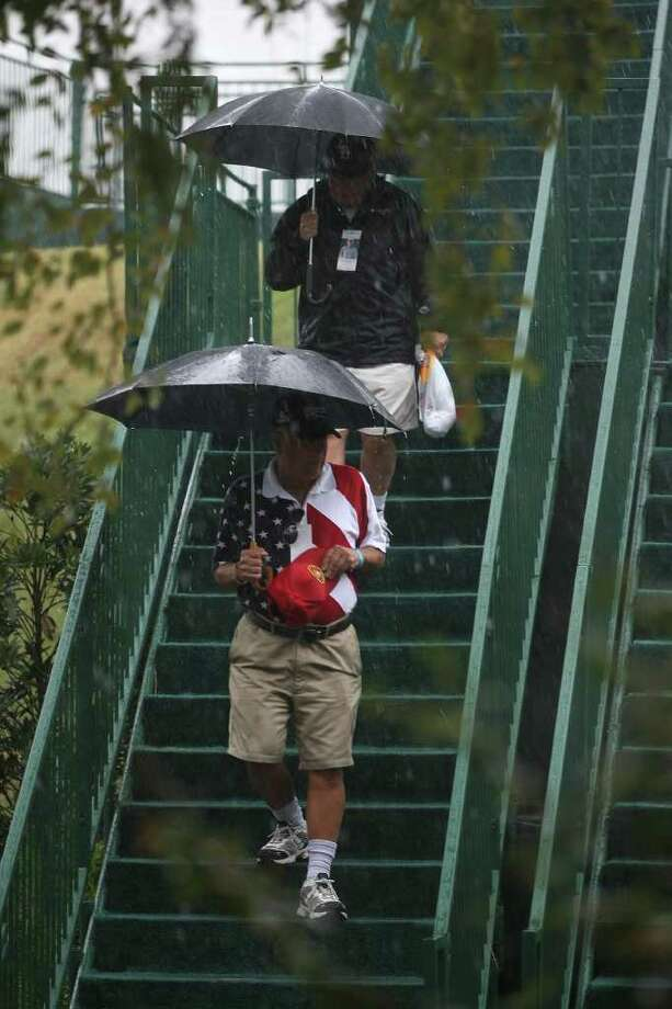 Patrons walk down the stairs from the sponsors tents at the No. 18 green during a weather delay at the final round of the Insperity Classic, Sunday, October 9, 2011 at the Tournament Course in The Woodlands, TX. The final round was canceled, and Brad Faxon was the winner at ten-under-par. Photo: Eric Christian Smith, For The Chronicle