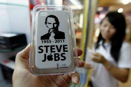 CHINAFOTOPRESS : GETTY IMAGES IN MEMORY: iPhone 4 hard case covers featuring a portrait of Steve Jobs were for sale in Shenzhen, China, this week. Apple co-founder Jobs died Wednesday at age 56. Photo: ChinaFotoPress / 2011 ChinaFotoPress