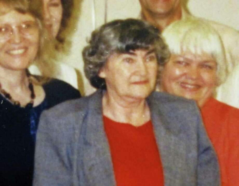 ASSOCIATED PRESS VICTIM: Mary Coleman, center, shown at a retirement party, was on the floor of the family home for days until she died. / Courtesy Mary Coleman