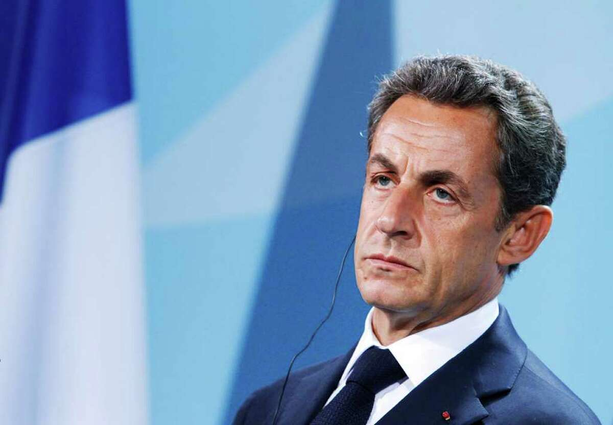 MICHELE TANTUSSI : BLOOMBERG TWO LEADERS: German Chancellor Angela Merkel and French President Nicolas Sarkozy said Monday they would complete a plan by month's end to make sure European banks have adequate capital. Investors have worried that European leaders weren't moving fast enough.