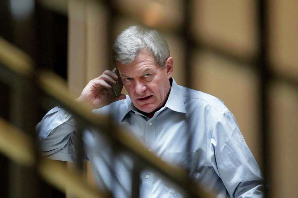 FILE - In this Sept. 27, 2011, file photo Supercommittee member Sen. Max Baucus, D-Mont., chairman of the Senate Finance Committee, talks on his cell phone outside a closed-door meeting of the Joint Select Committee on Deficit Reduction on Capitol Hill in Washington. After weeks of secret meetings the supercommittee seems no closer to reaching its assigned goal of at least $1.2 trillion in deficit savings over the next 10 years than it was when talks began. Lawmakers, aides and lobbyists closely following the group are increasingly skeptical, even pessimistic. (AP Photo/J. Scott Applewhite, File)