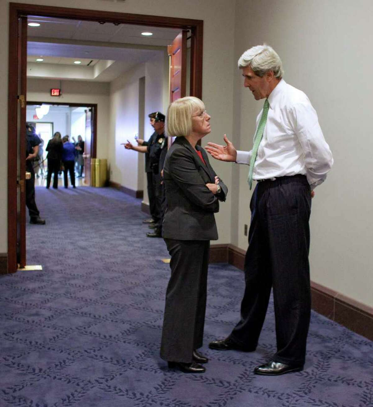 FILE - In this Oct. 6, 2011, file photo Supercommittee co-chair Sen. Patty Murray, D-Wash., left, talks with Supercommittee member Sen. John Kerry, D-Mass., in a hallway on Capitol Hill during a break in the Supercommittee's meeting in Washington. After weeks of secret meetings the Supercommittee seems no closer to reaching its assigned goal of at least $1.2 trillion in deficit savings over the next 10 years than it was when talks began. Lawmakers, aides and lobbyists closely following the group are increasingly skeptical, even pessimistic. (AP Photo/Harry Hamburg, File)