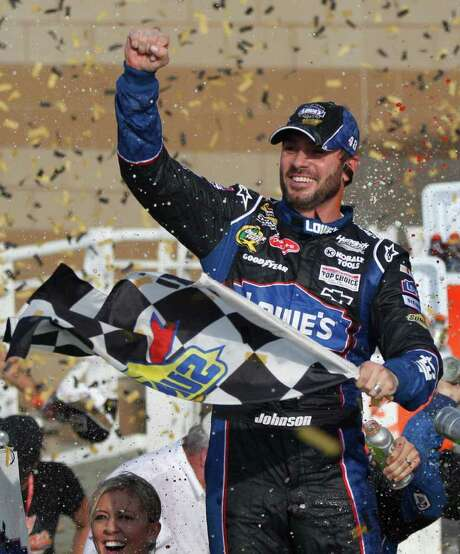 ORLIN WAGNER: AP RITE OF FALL: Jimmie Johnson collects a checkered flag Sunday that puts his bid for a sixth consecutive Sprint Cup championship on the right track. Photo: Orlin Wagner / AP