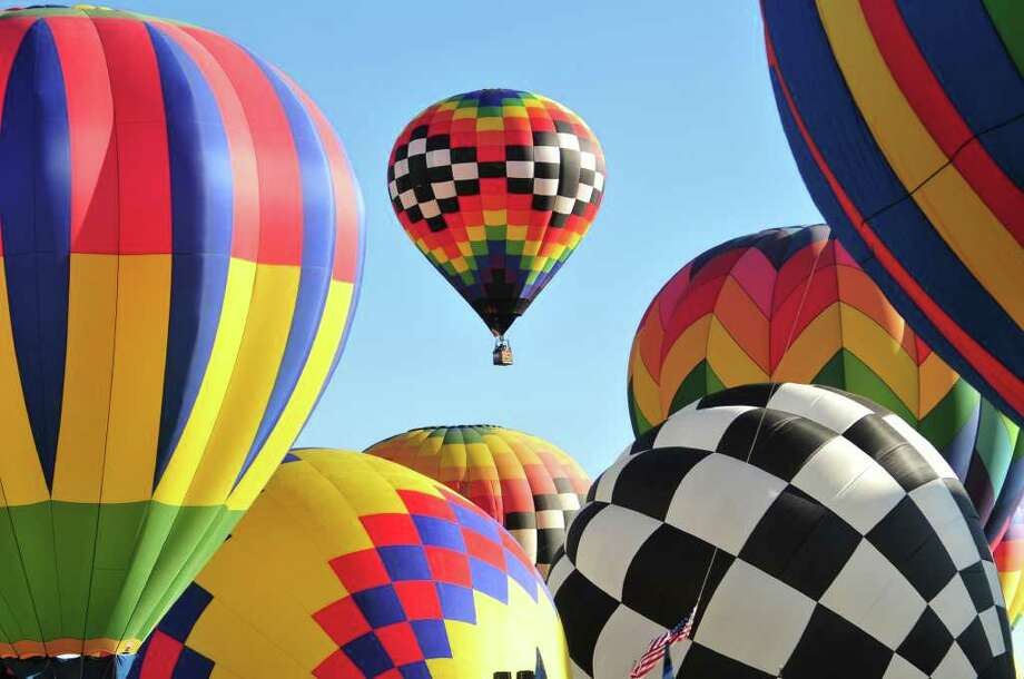 Balloons from more than 20 countries including the U.S come to Albuquerque, N.M. for the International Balloon Fiesta. More than 500 balloons fill the air in early October.  Nick Layman/Special to the Express-News Photo: Nick Layman