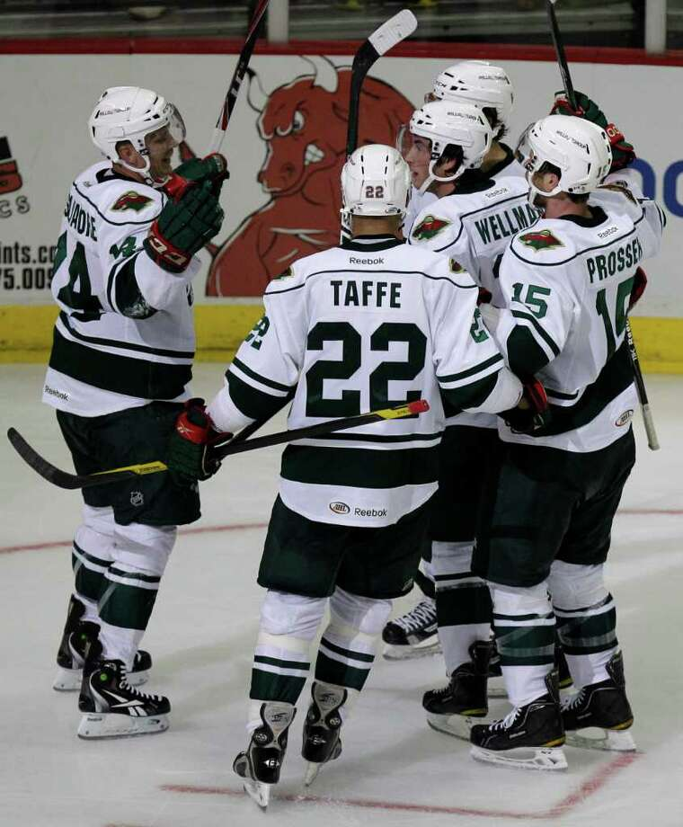 Houston Aeros Jon DiSalvatore, left, celebrates his power play goal with teammates (22) Jeff Taffe, Casey Wellman, center, Kris Foucault, back center, and (15) Nate Prosser, right, during the third period of AHL game against the Chicago Wolves at Toyota Center, Sunday, Oct. 9, 2011, in Houston.   Kris Foucault and Jeff Taffe assisted on the goal. Photo: Melissa Phillip, Houston Chronicle / © 2011 Houston Chronicle