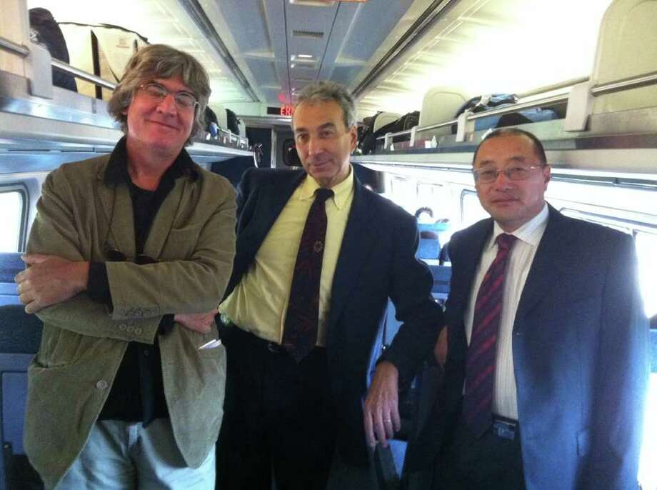 Italian documentary maker Francesco Lizzani,  Italian professor Raffaelo Milani  and Wang Gong Quan, a Chinese businessman were  aboard the stalled train at the South Norwalk station because a bridge over Norwalk Harbor failed to close properly. Photo: Vinti Singh