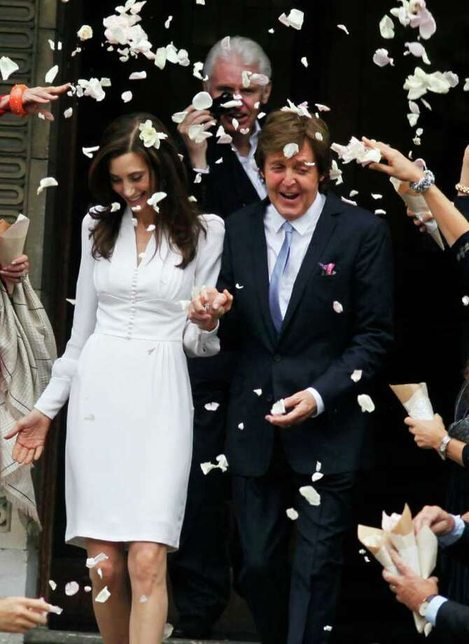 JIM ROSS : ASSOCIATED PRESS GETTING BETTER: Former Beatle Paul McCartney and American businesswoman Nancy Shevell exit Marylebone Town Hall in London after their wedding Sunday afternoon. Photo: Jim Ross / AP