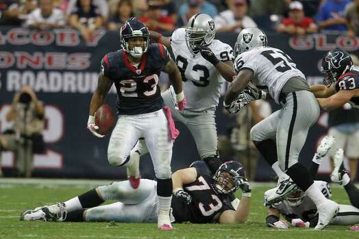 Houston Texans running back Arian Foster (23) gains a few yards in the fourth quarter of an NFL football game at Reliant Stadium, Sunday, Oct. 9, 2011, in Houston. Raiders won the game 25-20. Photo: Karen Warren, Houston Chronicle / © 2011 Houston Chronicle