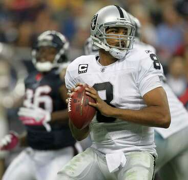 Oakland Raiders quarterback Jason Campbell (8) drops back to pass the ball in the third quarter of an NFL football game at Reliant Stadium, Sunday, Oct. 9, 2011, in Houston. Photo: Karen Warren, Houston Chronicle / © 2011 Houston Chronicle