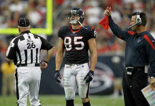 Houston Texans tight end Joel Dreessen (85) reacts as Houston Texans head coach Gary Kubiak gets ready to throw  the coaches challenge flag after Dreessen's catch was challenged in the third quarter of an NFL football game at Reliant Stadium, Sunday, Oct. 9, 2011, in Houston. Photo: Karen Warren, Houston Chronicle / © 2011 Houston Chronicle
