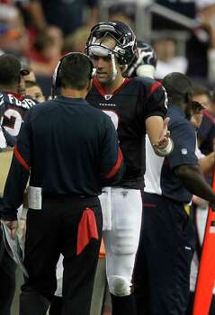 Houston Texans quarterback Matt Schaub (8) tries to explain a play to  head coach Gary Kubiak on the sidelines during the fourth quarter of an NFL football game at Reliant Stadium, Sunday, Oct. 9, 2011, in Houston. Raiders won the game 25-20. Photo: Karen Warren, Houston Chronicle / © 2011 Houston Chronicle