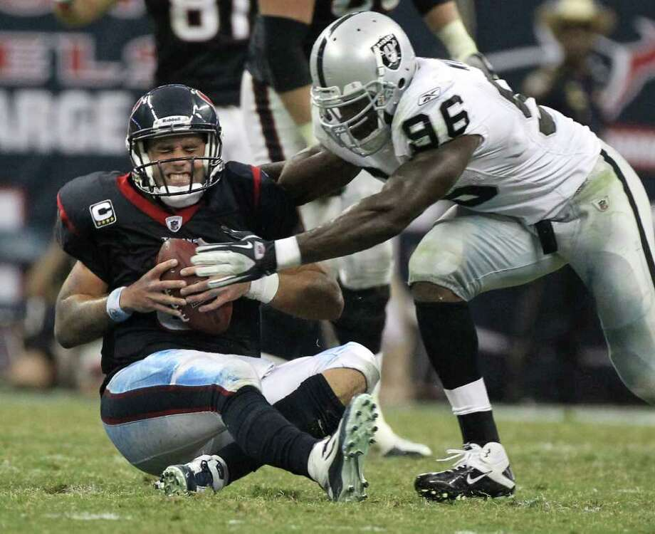 Houston Texans quarterback Matt Schaub (8) gets sacked by Oakland Raiders linebacker Kamerion Wimbley (96) after he mishandled a snap during the fourth quarter of an NFL football game at Reliant Stadium on Sunday, Oct. 9, 2011, in Houston. The Oakland Raiders won 25-20. Photo: Nick De La Torre, Houston Chronicle / © 2011  Houston Chronicle