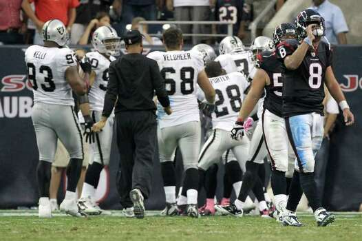 Houston Texans quarterback Matt Schaub (8) walks off the field as the Oakland Raiders celebrate winning the game 25-20. Schaub threw an interception to end the game as time ran out of an NFL football game at Reliant Stadium on Sunday, Oct. 9, 2011, in Houston. The Oakland Raiders won 25-20. Photo: Nick De La Torre, Houston Chronicle / © 2011  Houston Chronicle