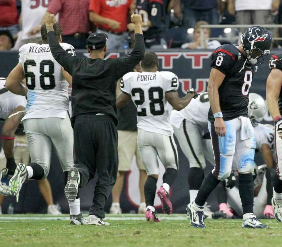 Oct. 9: Raiders 25, Texans 20. Houston Texans quarterback Matt Schaub (8) walks off the field as the Oakland Raiders celebrate winning the game 25-20. Schaub threw an interception to end the game as time ran out of an NFL football game at Reliant Stadium on Sunday, Oct. 9, 2011, in Houston. The Oakland Raiders won 25-20. Photo: Nick De La Torre, Houston Chronicle / © 2011  Houston Chronicle